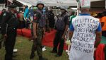 Police stand guard during a demonstration in Lagos on May 1