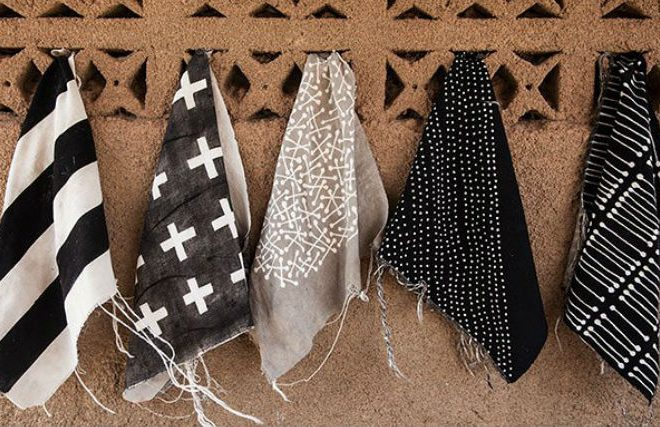 Traditionally dying fabric with fermented mud: Mali