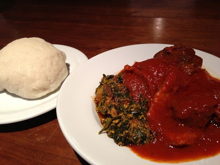 A plate of pounded yam (Iyan) and egusi soup.
