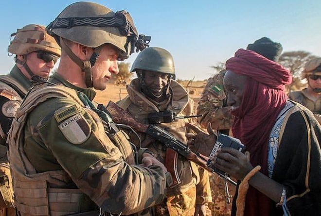 Why is Mali still under French protection, 57 years after independence?