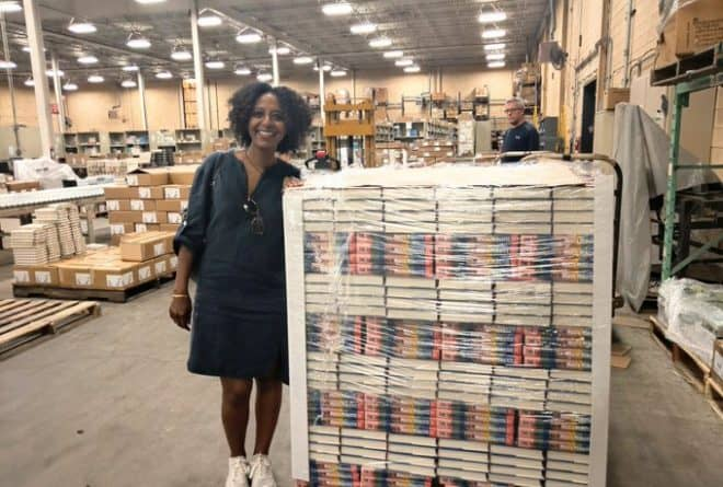 Ethiopian writer Maaza Mengiste hand signs three forklifts of her new book The Shadow King