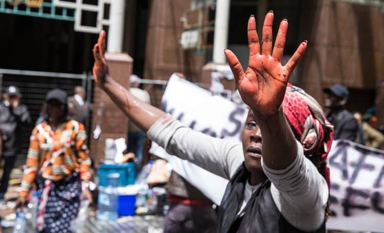 Photo essay: Chaos in Cape Town as refugees evicted from city centre protest