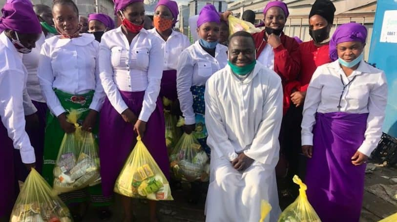Priest helps struggling Malawians with food parcels